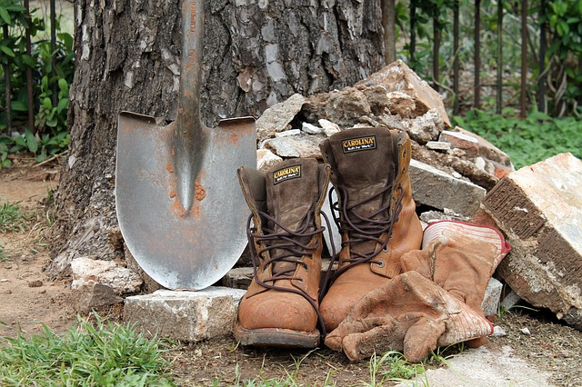 work boots and shovel